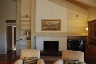 Traditional fireplace and flat-screen TV